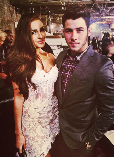 Olivia Culpo and Nick Jonas at the Sherri Hill NYFW show