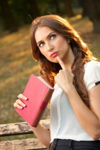 College Girl Holding Textbook